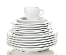 stacked clean plates with a cup on top